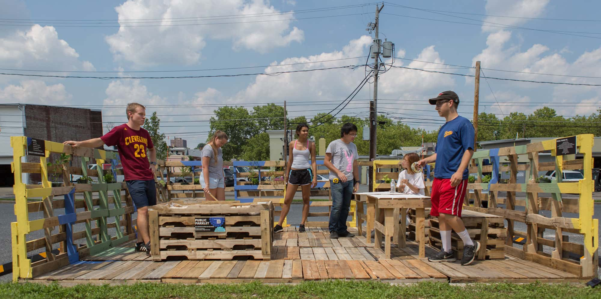 Students working on a parklet made of wood pallets