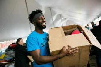 Aarsenio Perry carries a box at Lehigh University's Great South Side Sale