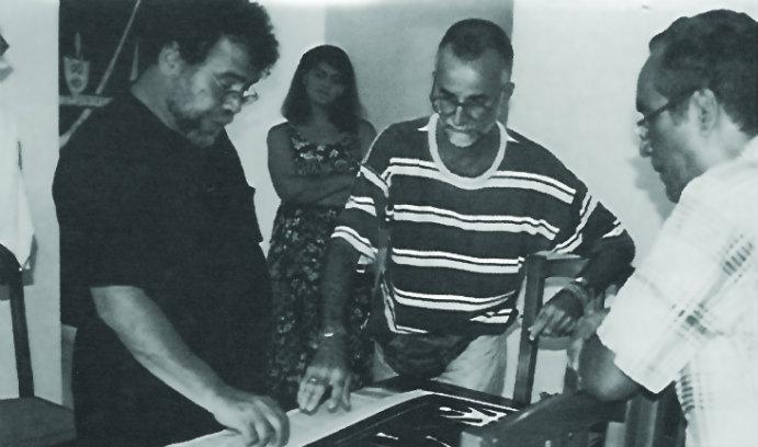 Ricardo Viera and Juan Castillo Vazquez examine Wifredo Lam art.