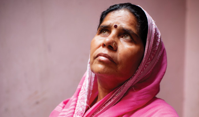 Indian woman dressed in pink sari.