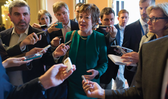 Senator Susan Collins answers reporters' questions in 2013.