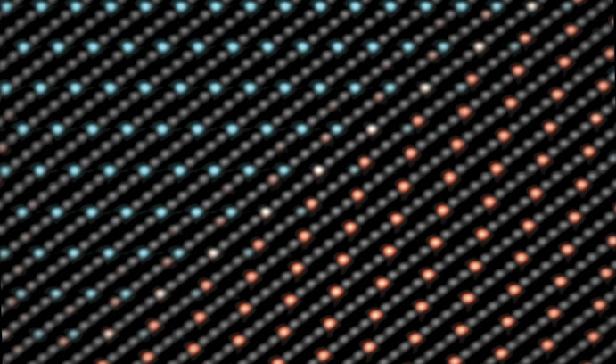 Red and blue dots in an atomic-resolution image of a twin boundary in nanocrystalline Ni-W.