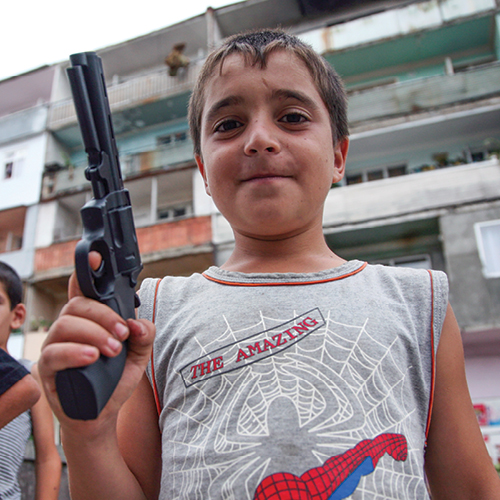 Child holding gun
