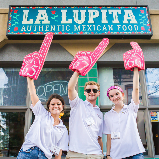 student standing in front of La Lupita