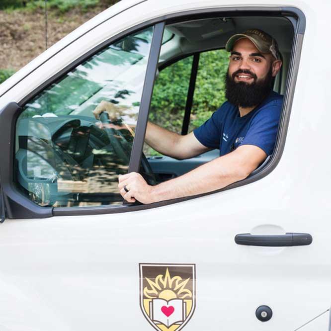 Jordan Strause sitting in a Lehigh truck