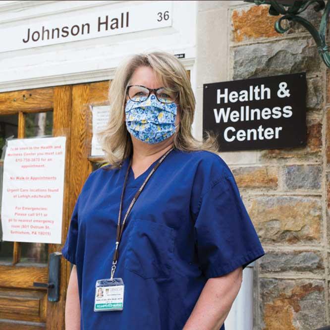 Karen Sicinski standing in front of the Health & Wellness Center