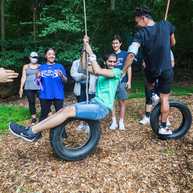 student swinging on a tire swing