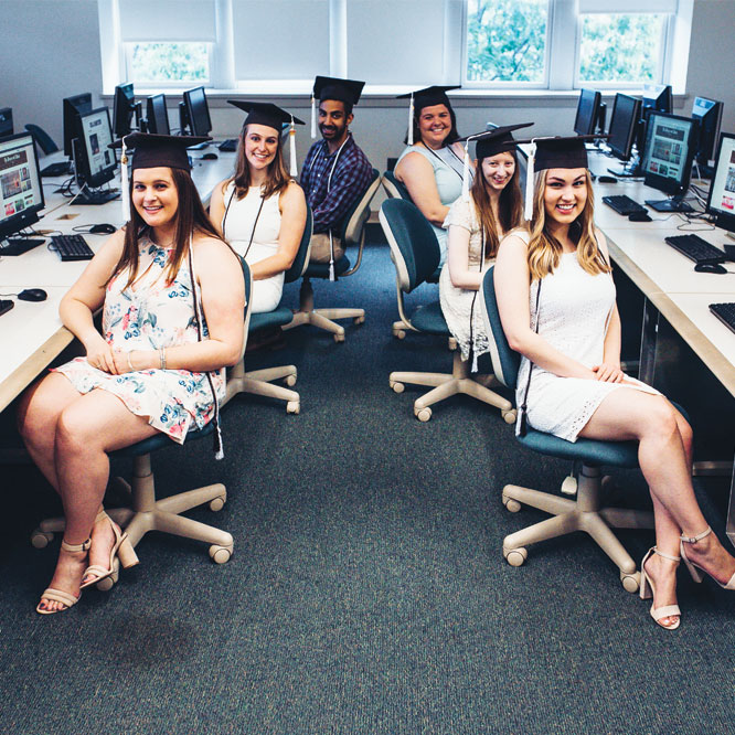 Brown and White graduating seniors pose in Copee where they spent so much time together.