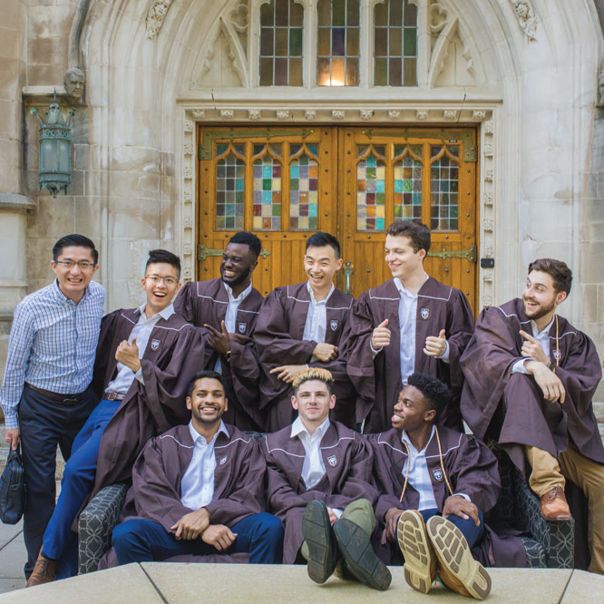 """Professor Tansu photobombs these """"friends since first-year"""" graduation photoshoot outside Packard Lab."""