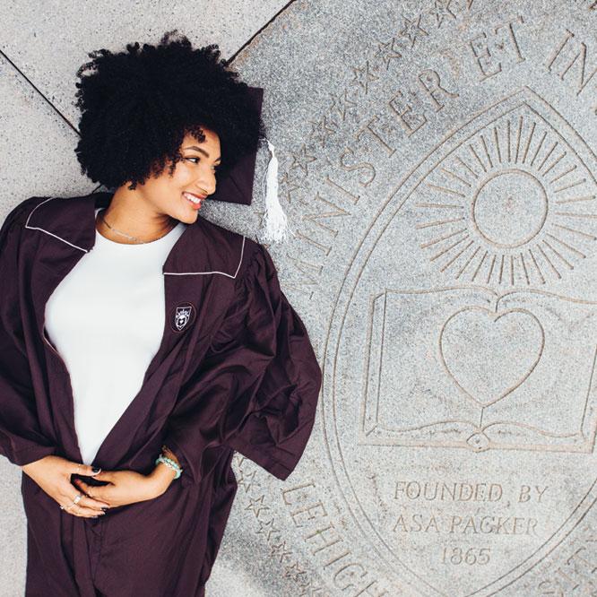 Malika Kumbella' 19 poses with the Lehigh seal in Leadership Plaza.