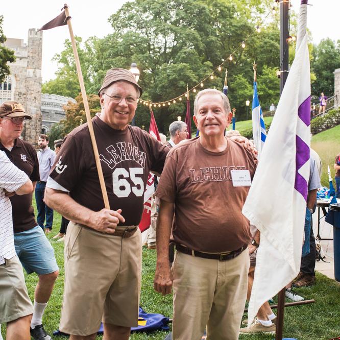 Two Lehigh alumn standing at Lehigh University Rally