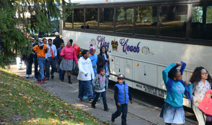 Success Academy students getting off the bus at Lehigh