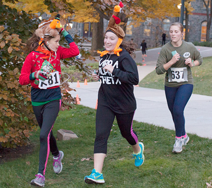 Three people running in the Turkey Trot