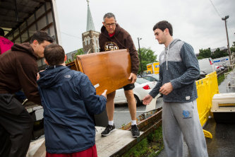 Volunteers move furniture at Lehigh University's Great South Side Sale.