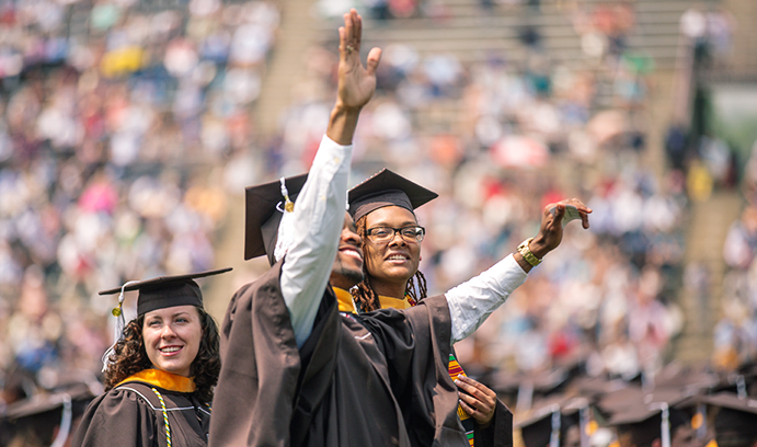 Class of 2015 graduate waves to crowd
