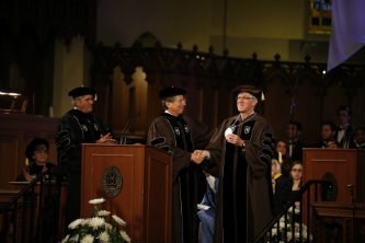 Scheler and Simon during the installation ceremony.