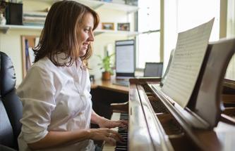 Gilligan at piano