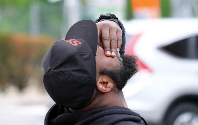The mental health of some people in black communities, says Sirry Alang, is closely tied to poverty, poor housing and other social structures in which they live. (Photo by Jewel Samad/Getty Images)