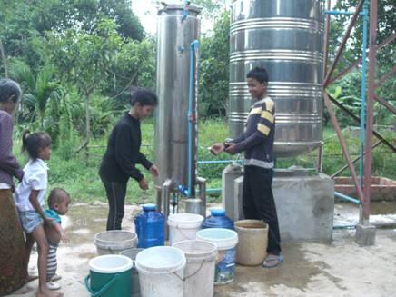 Children in Cambodia operate an arsenic-removal system that was installed by the Tagore-SenGupta Foundation.