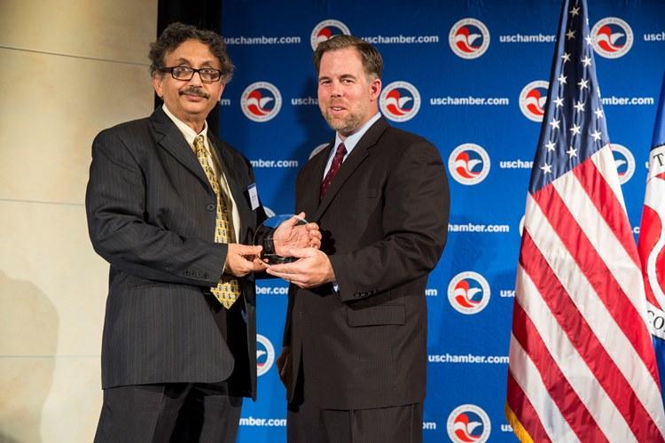SenGupta (left) receives the IP Champion Award from Patrick Kilbride
