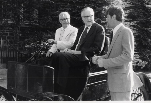 Early in his Lehigh career, Bolle met with Thomas Jackson, professor of mechanical engineering (left), and Lehigh President W. Deming Lewis (center), are seated in Old Number One, the first Packard car ever built. (Photo from Lehigh University Archives)