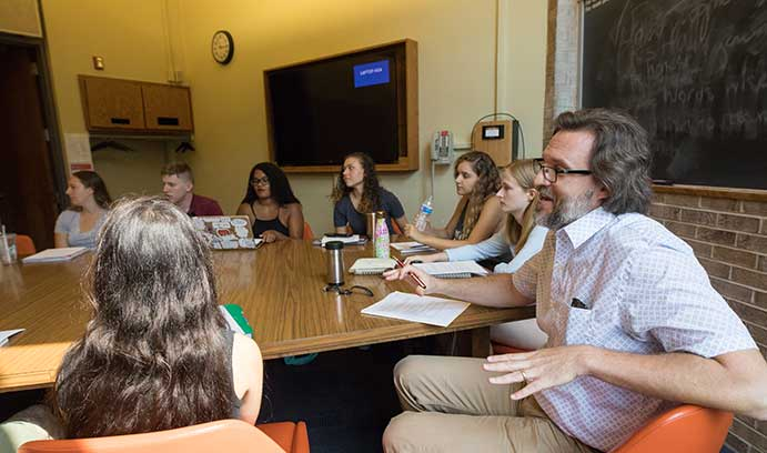 Students and professor have a discussion in Lehigh University classroom.