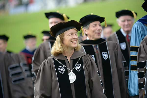 Lehigh President Alice P. Gast leads the honorary degree recipients onto the field at Goodman Stadium before ceremonies begin.