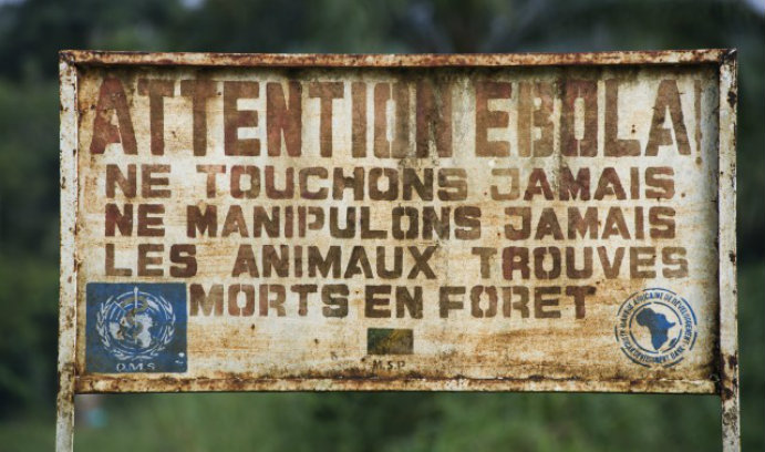 """Sign in Odzala-Kokoua National Park in the Democratic Republic of the Congo that says """"Warning, Ebola!"""""""
