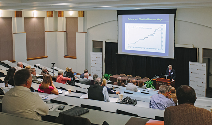 Impact symposium focuses on earnings issues