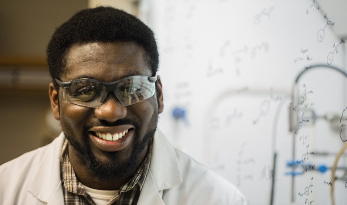 Godfred Fianu, who successfully defended his Ph.D. thesis in August, developed a method of carrying out simple reductions of carbonyls such as ketones and aldehydes to obtain alcohols. (Photo by Christa Neu)