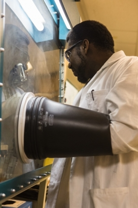 In addition to this air-free glove box, Fianu in his research used gas chromatography mass spectrometry and nuclear magnetic resonance, SpectroVis and ReactIR, which monitors a reaction in real time. (Photo by Christa Neu)