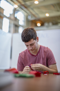 Jeff Peisner, who is studying mechanical engineering, works on a prototype.