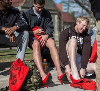 A contingent of Lehigh men strap on high heels as they prepare to participate in the annual Walk a Mile in Her Shoes event sponsored by Lambda Theta Alpha Latin Sorority Inc.
