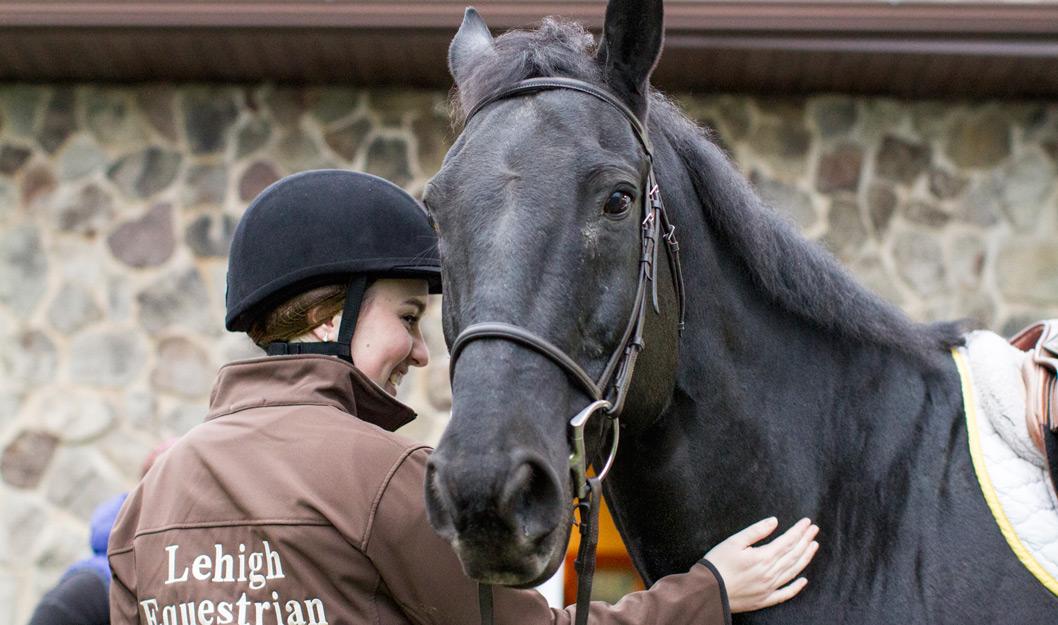 Lehigh student in Lehigh's Equestrian club with a horse