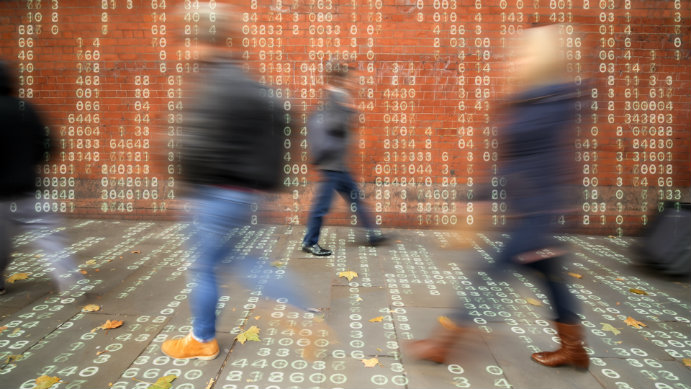 Image of legs walking in front of brick wall with data overlay on image