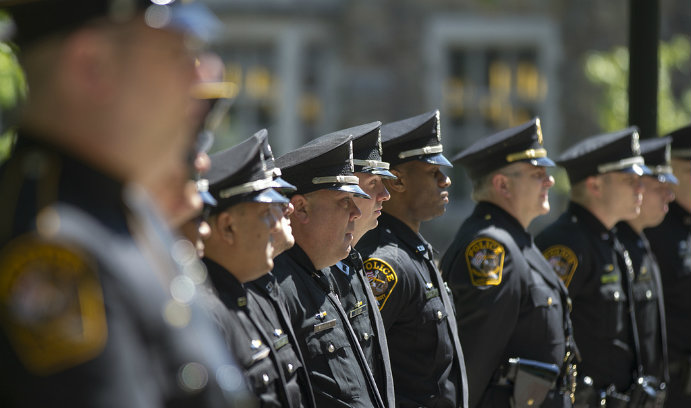 Lehigh University police officers stand in line at a ceremony.
