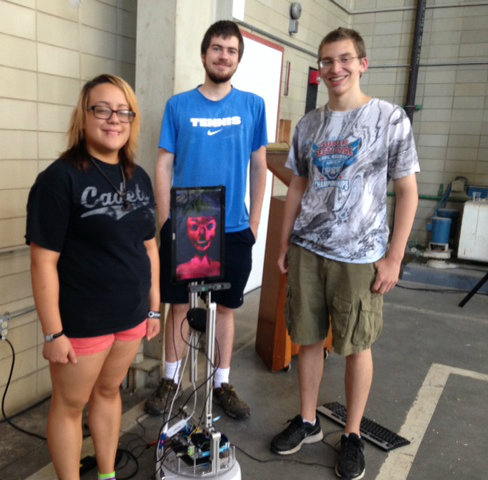 From left, Cassandra Guerrero, Dan Coombe and Chris Garman pose with LILI, the robot. Photo by Mary Ellen Alu