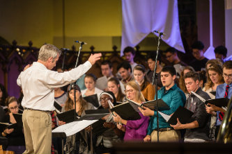 Steven Sametz directs a rehearsal on the eve of Founder's Day.