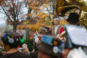 The Lord Mayor of Westminster Catherine Longworth watches the Lehigh Marching 97 play.
