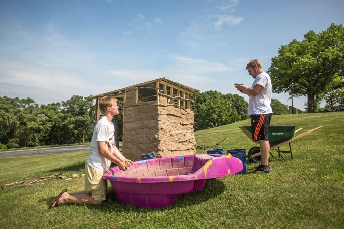 From left, Shane McDevitt and and Dylan Friedgen-Veitch work on the hut. Photo by Christa Neu