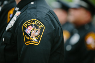 An LUPD patch on a police officer's uniform