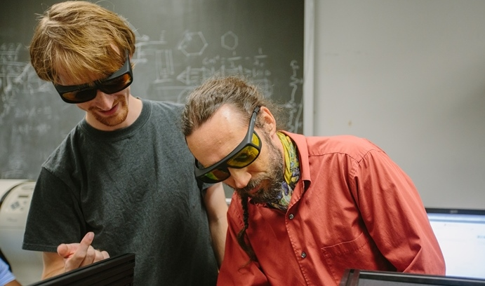 Michael Blades, a graduate student in physics, works with Rotkin on a new optics system that he built in Rotkin's lab. This system characterizes novel materials and explores the nature of interactions at the nanoscale.