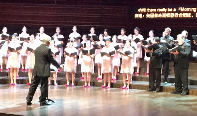 Steven Sametz conducts the Shenzhen Lily Children's Choir and The Princeton Singers in a performance at the Shenzhen Concert Hall in China. The concert culminated the Fourth Shenzhen International Choral Festival.