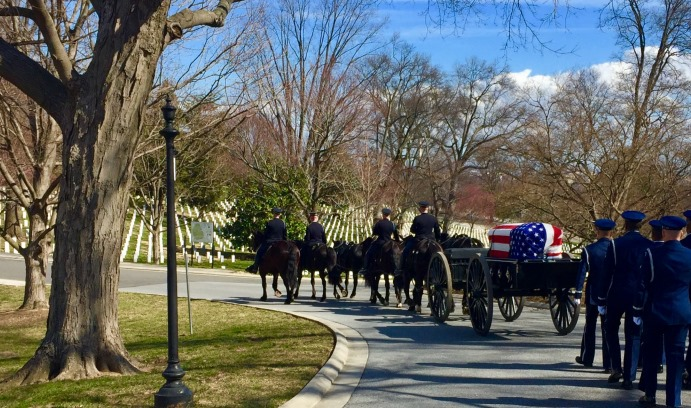 A military honor guard escorts the remains of Air Force Col. Thomas Schaefer '53 to his gravesite at Arlington National Cemetery. Schaefer was the ranking military officer among 52 Americans held hostage in the U.S. Embassy in Iran from 1979-81.