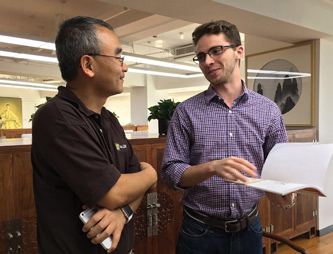 Oliver Yao, chair of the Department of Management, and John Larson '17.