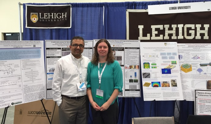 Yatin Karpe (left) stands with Kelly Schultz at the Lehigh booth. Schultz's paper on cell-material interactions was accepted for a Technical World Conference Presentation at the TechConnect conference.