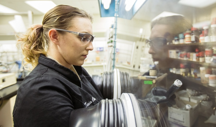 Tesia Chciuk works with samarium inside an air-free glove box. Chciuk recently earned a Ph.D. in chemistry and became the first Lehigh student to win the Anna Louise Hoffman Award for Outstanding Achievement in Graduate Research.