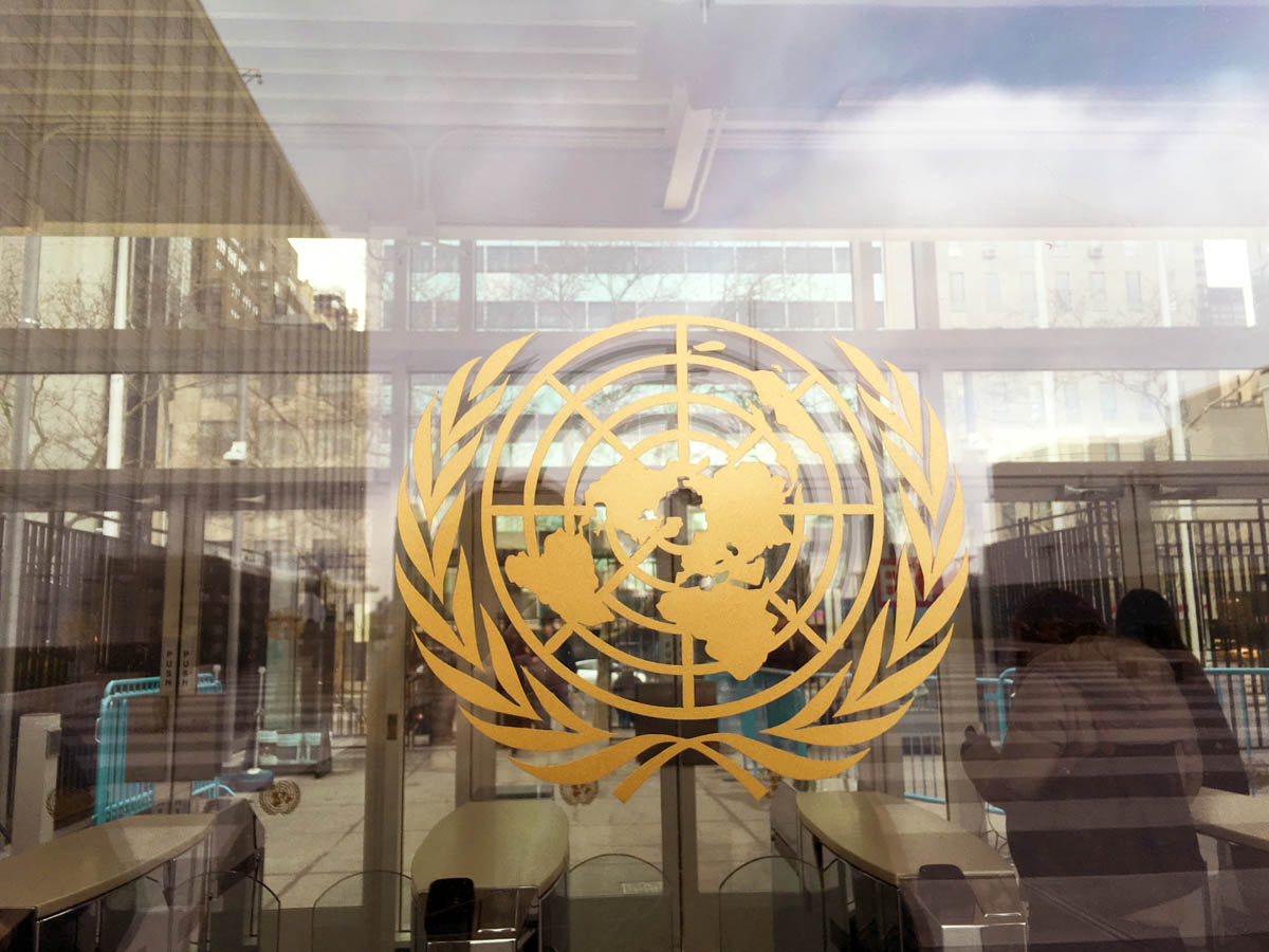 United Nations logo on a window