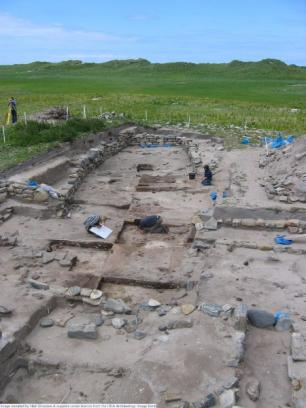 Archaeologists dig at an excavation site in Bornais on the island of South Uist. (Photo courtesy of Niall Sharples and the HCA Archaeology Image Bank)