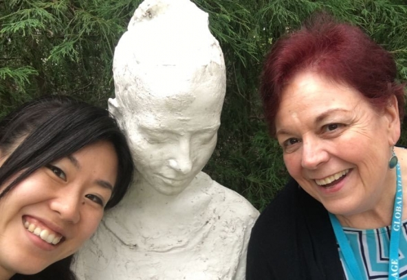Ayako Inose (left), manager of the Bangladeshi office for a Japanese NGO, poses at a campus landmark with Mary Frances Schurtz-Leon, candidate manager for Global Village.